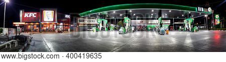 Bangkok, Thailand - December 20: Pt Fuel Service Station And Kfc Operates 24 Hours Though The Night