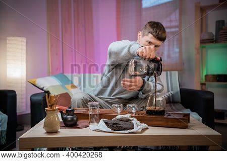 A Young Man Is Introduced To The Chinese Culture Of Tea Drinking. Brews Fragrant Raw Tea At Home. Po