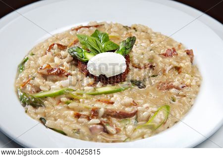 Risotto With Mushrooms And Dried Tomatoes With Goat Cheese