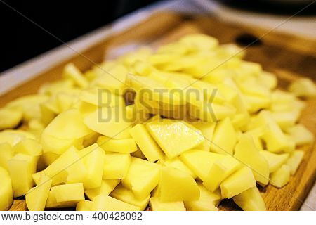 Chopped Potatoes On A Cutting Board With A Close-up. Cooking. Vegan Food.