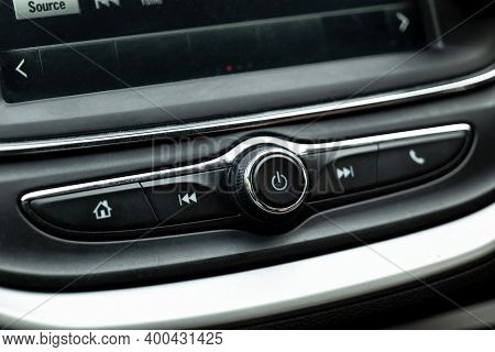 Power Button And Various Controls Of A Car Radio In An Interior Of A Modern Vehicle