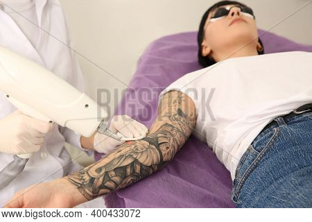 Young Woman Undergoing Laser Tattoo Removal Procedure In Salon