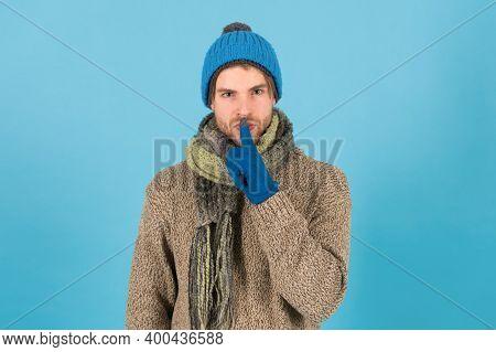 Keep My Secret. Man Handsome Unshaven Guy Wear Winter Accessories On Blue Background. Winter Season