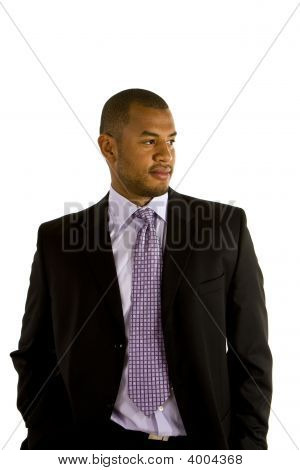 Black Man In Suit Hands In Pockets Looking To Side