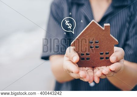Copyspace Model Of A Little House That Woman Holds It Background. Deam Life Have Own House Property