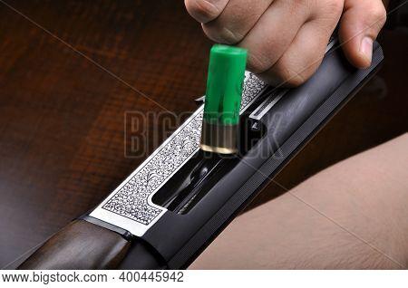 Shotgun Bullet And Trigger Mechanism Isolated On Wooden Background, Hunting Shotgun Detail