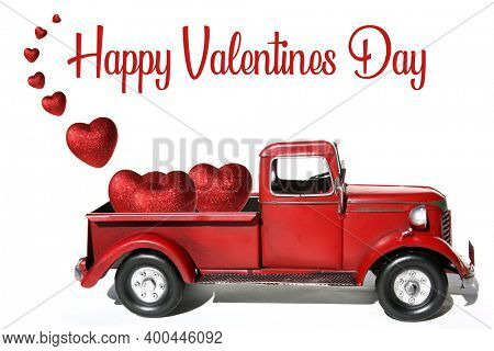 Red Pick Up Truck. Valentines Day. Red Pick Up Truck with Red Valentines Day Hearts. Isolated on white. Room for text. Happy Valentines Day.