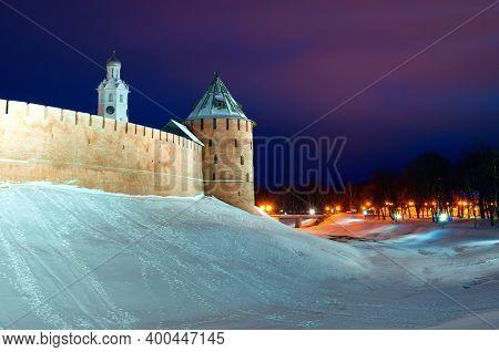 Winter Night Landscape Of Veliky Novgorod, Russia. Towers Of Veliky Novgorod Kremlin Fortress In Win