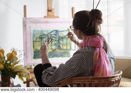 Woman Artist Painting On Canvas At Home. Woman Artist Painting At Home. Hipster Lifestyle. Beautiful