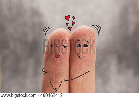Two Fingers Are Like Two People Who Love Each Other. The Man Hugs And Kisses The Woman. Family, Love