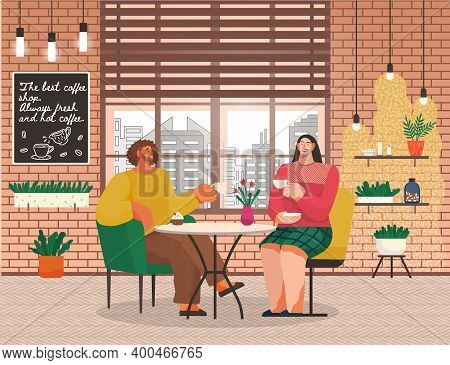People Drinking Coffee And Talking With Each Other In Cafe. Man And Woman On Date Or Friends Meeting