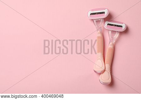 Two Razors On Pink Background, Space For Text