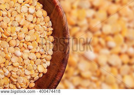 Dry Peas Background. Yellow Dry Split Peas In Wooden Bowl. Empty Copy Space Food Background. Split D