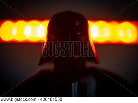 DEC 20 2020: dark portrait of Star Wars Sith Lord Darth Vader - Hasbro Action Figure