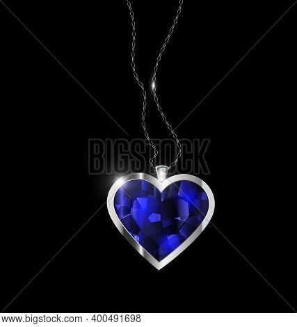 Black Background And Jewel Pendant Blue Heart With Golden Chain