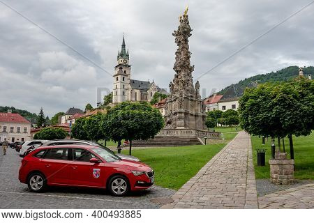 Kremnica, Slovakia - July 3, 2020: Cars Parked In Front Of Kostol Sv. Katariny Alexandrijskej Church