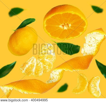 Fresh Tangerine Levitation With Leaves Falling In The Air. Cut And Whole Tangerine Isolated On Yello