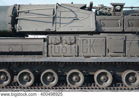 Close Up Of Green Armoured Caterpillar Transport. Modern Military Transportation Vehicle Technologie