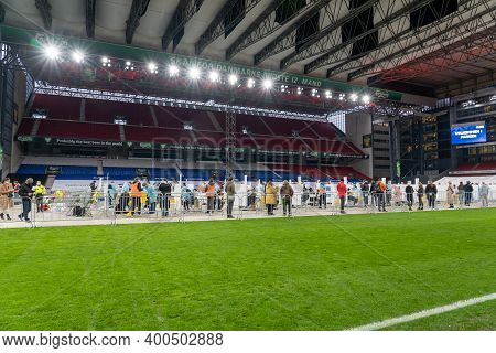 Copenhagen, Denmark - December 22, 2020: People Queuing At The Corona Test Facility At The National