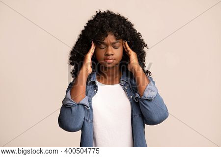 Upset African American Young Lady In Casual Outfit With Curly Hair Having Headache, Touching Her Tem