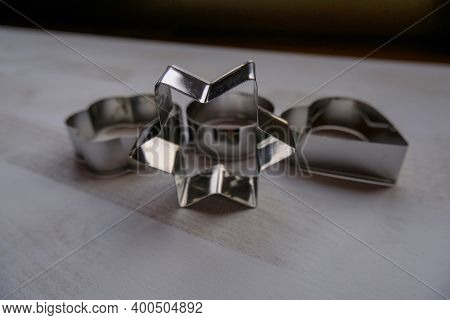 Silver Metal Star-shaped Biscuit Cutter, Mold For Baking On White Background Across Other Shaped-bis