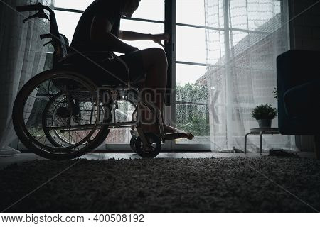 A Disabled Man Sitting In A Wheelchair Is Disappointed And Desperate To Heal After Car Accident. Con
