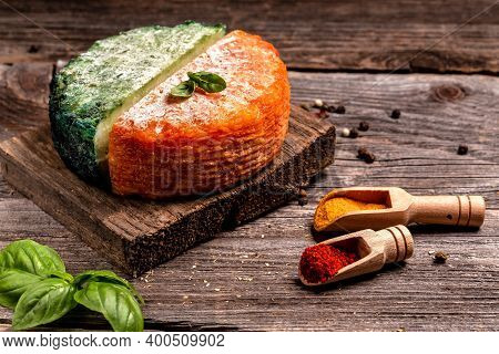 Cheese Collection, Piece Of Spanish Manchego Cheese With Red Paprika, Craft Cheese Green Pesto Chees