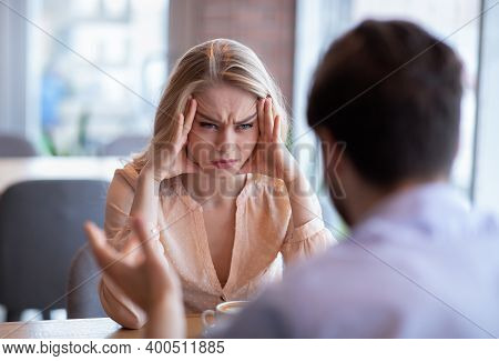 Relationship Problems, Divorce, Separation Concept. Unhappy Young Woman Having Conflict With Her Boy