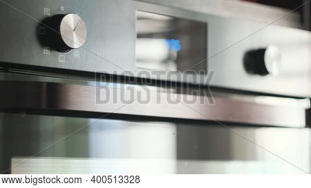Close-up Of Modern Plate Panel. Concept. Kitchen Stove Handles With Modern Stylish Design. Metal Gre