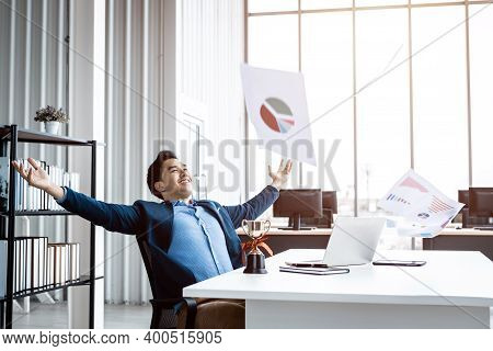 Happy Successful Of Asian Young Businessman For Threw Up The Business Plan In Document Paper Into Th