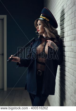 Sexy Girl In Police Uniform With A Baton