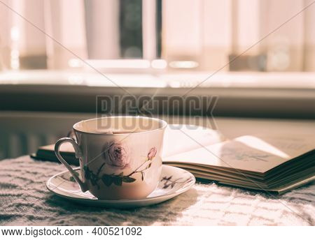 Hot Tea With Steaming In Cinematic Tone, Still Life Cuppa Tea With Steam On A Coffee Table With Morn