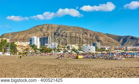 Los Cristianos, Tenerife, Spain - December 12, 2019: Wide sandy beach in Los Cristianos, Tenerife Island, The Canaries