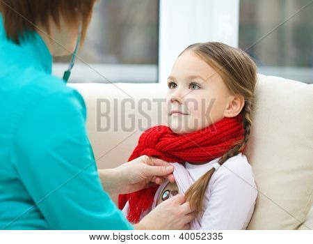 Doctor is examining a little girl using stethoscope, indoor shoot