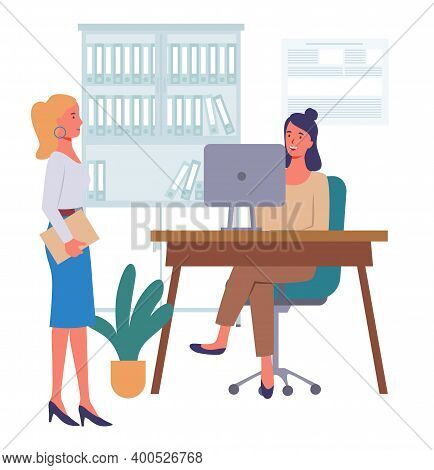 Businesswomen Dressed In Formal Clothes Siting At The Table With Computer, Standing In Room And Talk