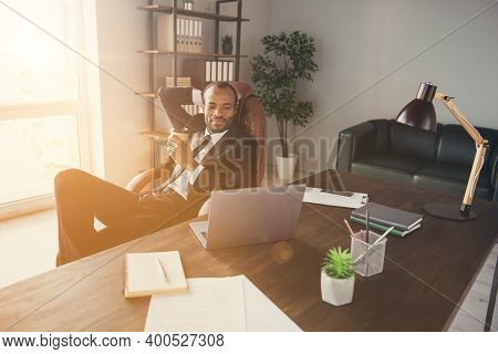Photo Of Handsome Dark Skin Business Man Agent Guy Notebook Table Read Corporate Report Insurance Br