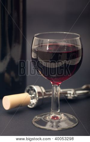 Glass, Corkscrew And Bottle Of Wine