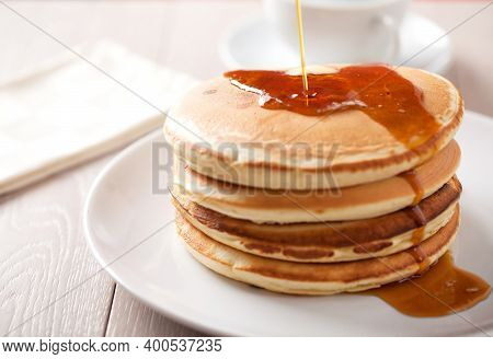 Delicious Pancakes With Maple Syrup On A Plate.