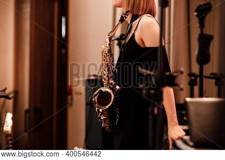 Woman Musical Instruments , Saxophone Player Hands Saxophonist Playing Jazz Music. Alto Sax Musical