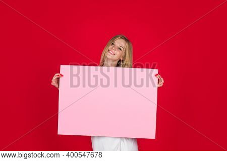 Woman Shows Empty Board. Advertising Board. Black Friday. Advertising. Smiling Woman Holds Empty Adv