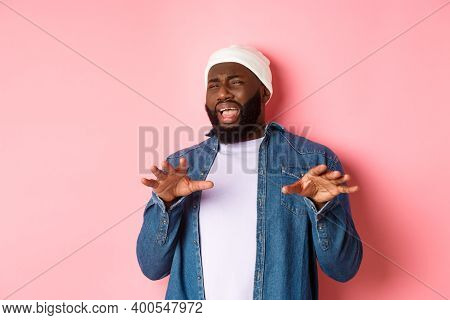 Image Of Disgusted Picky Black Man Cringe From Something Disturbing, Refusing Bad Offer, Grimacing W
