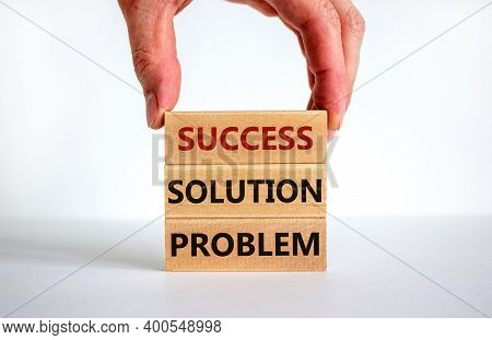 Problem Solution Success Symbol. Male Hand Placing A Blocks With Word 'success' On Top Of A Blocks T