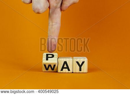 Way To Pay Symbol. Businessman Hand Turns A Cube And Changes The Word 'way' To 'pay'. Business And W