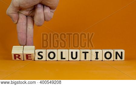 New Years Solution Or Resolution. Male Hand Flips Wooden Cubes And Changes Words 'solution' To 'reso