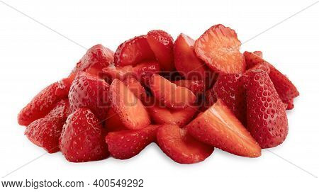 Strawberry Slices Heap Closeup On White Background. Defrosted Sliced Strawberries Isolated Macro Clo