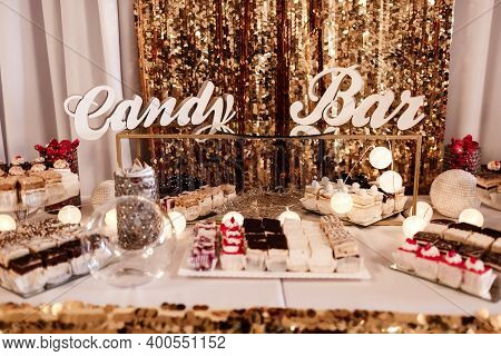 Delicious Sweet Buffet With Cupcakes. Sweet Holiday Buffet With Cupcakes And Other Desserts. Candy B