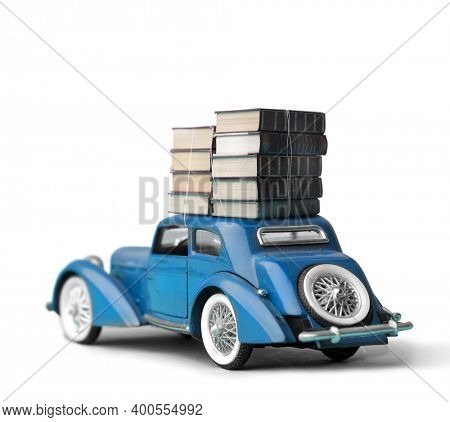 vintage model car with a stack of books on the roof