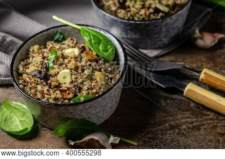 Two Bowls With Quinoa, Mushrooms, Garlic And Spinach