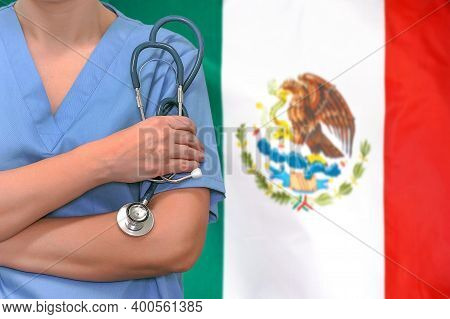 Female Surgeon Or Doctor With Stethoscope In Hand On The Background Of The Mexico Flag. Surgery Conc