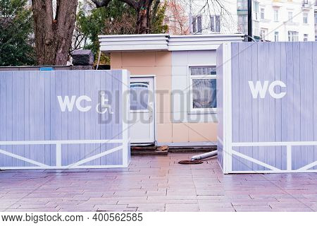 Wc Sign For Disabled And Common Persons On Drawn On The Grey Wooden Fence. Toilet. Restroom. Outdoor